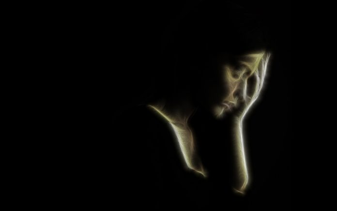 artistic portrait of sad woman